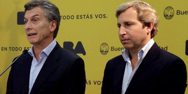 Minsitro Frigerio junto al presidente Macri.